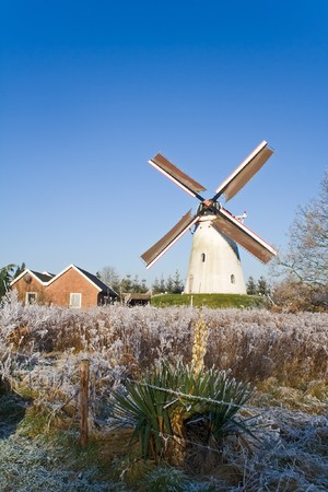 Windmill in Holland during winter photo