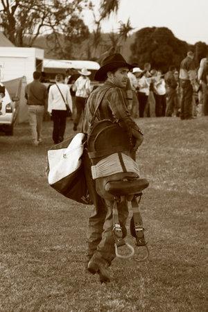 MACKAY, QUEENSLAND, AUSTRALIA - APRIL 22: 1955 Cowboy walking on the Rocking Vee Pro Rodeo on April 22, 2006 in Mackay, Queensland, Australia.