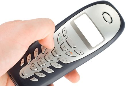 Household cordless telephone in hand Stock Photo - 7101342