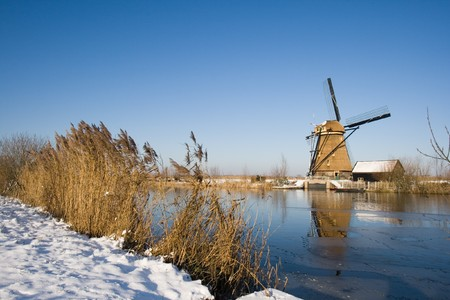 Dutch winter with windmill Stock Photo - 7395960