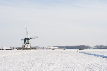 Winter landscape with windmill in Holland photo