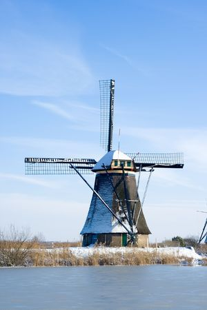 Dutch windmill in the Kinderdijk area during winter. Holland Stock Photo - 7485677
