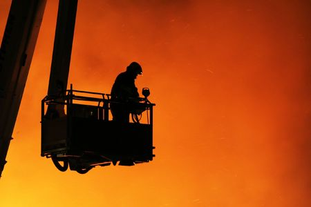 Fireman fighting a large fire Stock Photo