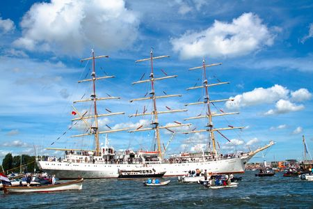 AMSTERDAM, THE NETHERLANDS - AUGUST 19: The Dar Mlodziezy tall ship arrives in the Amsterdam Harbour for SAIL 2010 August 19, 2010 in Amsterdam, The Netherlands Stock Photo - 7659887