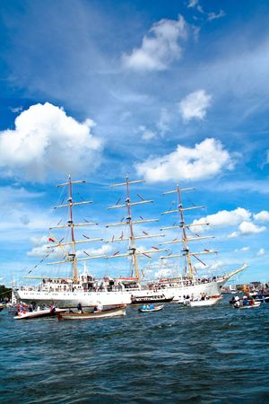 canal parade: AMSTERDAM, THE NETHERLANDS - AUGUST 19: The Dar Mlodziezy tall ship arrives in the Amsterdam Harbour for SAIL 2010 August 19, 2010 in Amsterdam, The Netherlands
