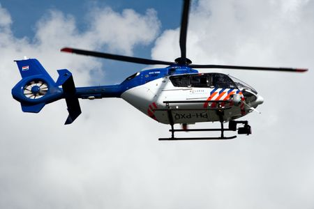 AMSTERDAM, THE NETHERLANDS - AUGUST 19: Dutch police helicopter patrolling the area of the SAIL event August 19, 2010 in Amsterdam, The Netherlands Editorial