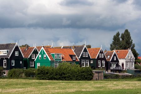 Traditional houses in the town of Marken, Holland photo