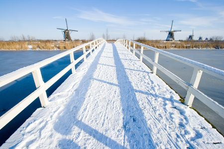 Bridge covered with snow on a winterday in Holland Stock Photo - 7761544