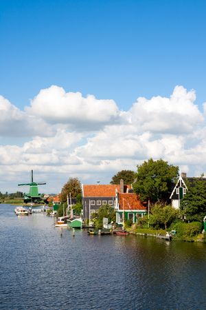 Windmill and historical houses at the famous Zaanse Schans in Holland Stock Photo - 7761595