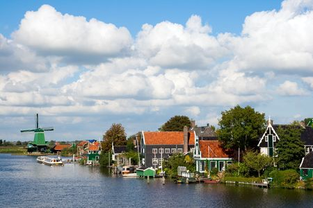 Windmills and historical houses at the famous Zaanse Schans in Holland photo