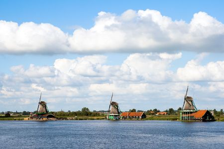 Windmills at the famous Zaanse Schans in Holland Stock Photo - 8032384