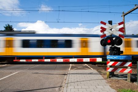High speed train passing a railway crossing Stock Photo - 8032388
