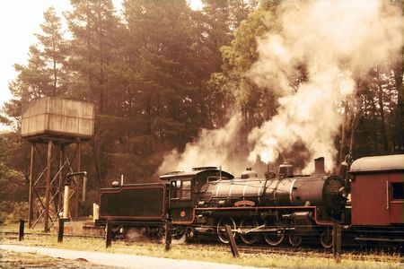 Departing steam train in sepia colours photo