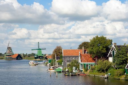 zaanse: Windmills and historical houses at the famous Zaanse Schans in Holland
