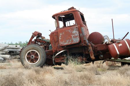 oldie: Old wrecked and rusted truck on a scrapyard
