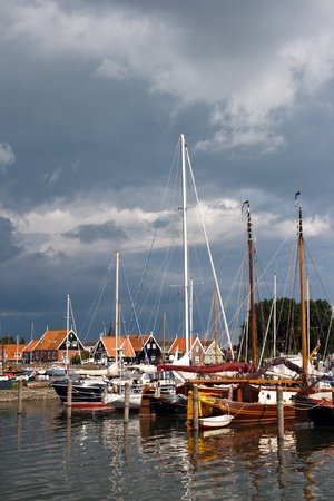 Small marina in the touristic town of Marken, Holland photo