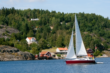Sail yacht on a lake in Sweden Standard-Bild