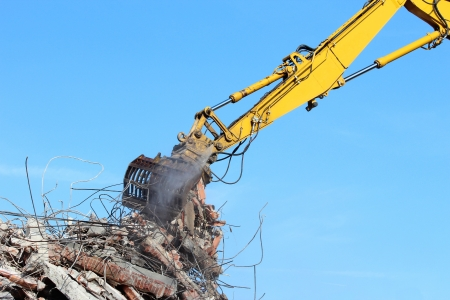 Demolition crane dismantling a building photo