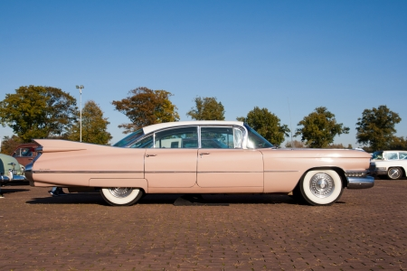 antique car: ROSMALEN, THE NETHERLANDS - OCTOBER 15: A 1959 Cadillac Sedan De Ville is shown at the Rock Around the Jukebox event on October 15, 2011 in Autotron Rosmalen, Holland