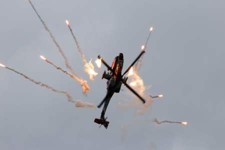 looping: VOLKEL, THE NETHERLANDS - JUNE 15: Dutch Army AH-64D Apache making a looping while firing flares on the Dutch Air Force Open Days. June 15, 2013 in Volkel, The Netherlands