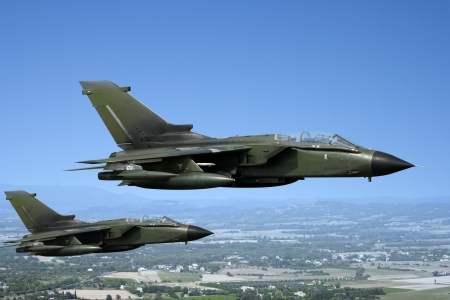 Two green fighter jets photo