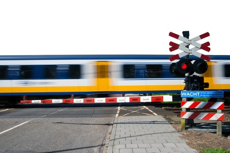 High speed train passing a railway crossing  photo