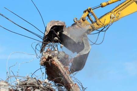 demolished: Demolition crane dismantling a building