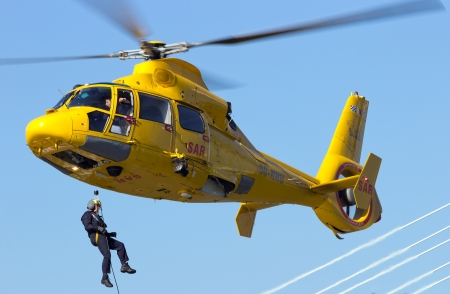 ROTTERDAM, HOLLAND - SEPTEMBER 7: Demonstration of a rescue operation by helicopter during the World Harbor Days in Rotterdam, Holland on September 7, 2012