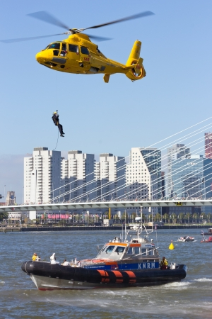 ROTTERDAM, HOLLAND - SEPTEMBER 8: Demonstration of a rescue operation by with a helicopter during the World Harbor Days in Rotterdam, Holland on September 8, 2012
