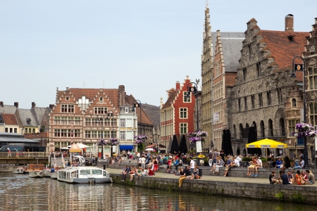 gabled: GHENT - JUN 18: Tourists and students in the historical center of Gent with its gabled houses along the canal in Gent June 18, 2013 in Ghent, Belgium