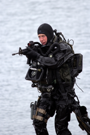 military invasion: DEN HELDER, THE NETHERLANDS - JUNE 23: Dutch Special Forces combat diver during an amphibious assault demo during the Dutch Navy Days on June 23, 2013 in Den Helder, The Netherlands