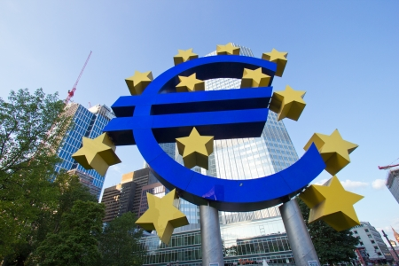 corporate greed: FRANKFURT, GERMANY - JUL 11: Euro sign outside the European Central Bank on July 11, 2013 in Frankfurt Germany. The ECB is building new premises in Frankfurt, due for completion in 2013.  Editorial