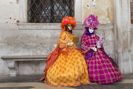 Costumed people on the Piazza San Marco during Venice Carnival