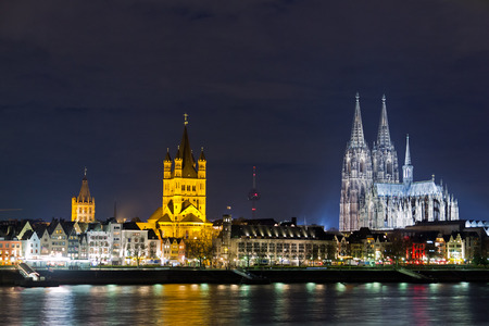 Riverside view of the Town Hall, church of Great St  Martin and Cologne Cathedral , Germany  photo