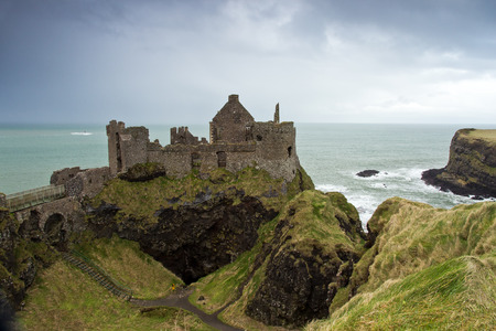 northern ireland: Dunluce Castle, a ruined medieval castle in Northern Ireland  Stock Photo