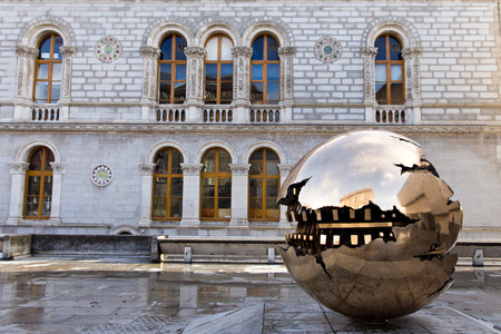 Abstract spherical metal sculpture on a courtyard of Trinity College in Dublin, Ireland