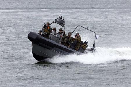 anti piracy: DEN HELDER, THE NETHERLANDS - JUNE 23: Dutch Marines in a speedboat during an assault demo at the Dutch Navy Days on June 23, 2013 in Den Helder, The Netherlands