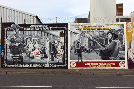 BELFAST, NORTHERN IRELAND - FEB 9, 2014: Political mural in Belfast, Northern Ireland. Falls Road is famous for its political murals.