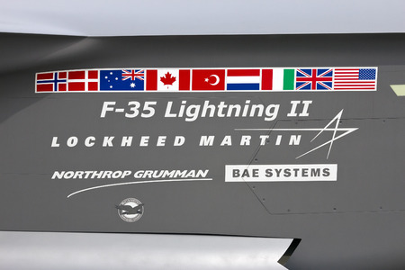 lockheed martin: VOLKEL, NETHERLANDS - JUNE 14: Participants of the Lockheed Martin F-35 Lightning JSF on a mockup JSF at the Royal Netherlands Air Force Days June 14, 2013 in Volkel, Netherlands.