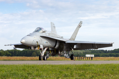 f18: VOLKEL, THE NETHERLANDS - JUNE 15: Finnish Air Force Boeing FA-18 Hornet at the Dutch Air Force Open Day on June 15, 2013 in Volkel, The Netherlands