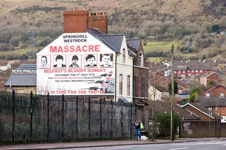 BELFAST, NORTHERN IRELAND - FEB 9, 2014: Mural of Springhill westrock massacre on Springfield Road in Belfast, Northern Ireland. Springfield Road was the site of much activity during the Troubles. Editorial