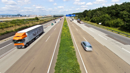 FRANKFURT, GERMANY - JULY 11: Traffic on a German highway on July 11, 2013 in Frankfurt, Germany. German autobahns have no general speedlimit and rank as the fifth longest highway system.