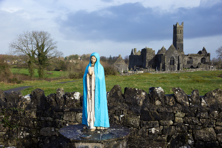 quin: Maria in front of Quin Abbey, County Clare, Ireland  Editorial