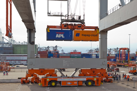 ROTTERDAM - SEP 8  Gantry crane operator moves containers on Sep 8, 2013 in Rotterdam, Netherlands  The port is the Europ