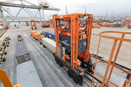 facilitate: ROTTERDAM - SEP 8  Container terminal and cranes on Sep 8, 2013 in Rotterdam, Netherlands  The port is the largest in Europe and facilitate the needs of a hinterland with 40,000,000 consumers