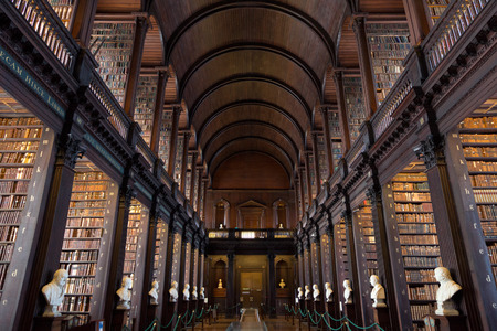 literature: DUBLIN, IRELAND - FEB 15: The Long Room in the Trinity College Library on Feb 15, 2014 in Dublin, Ireland. Trinity College Library is the largest library in Ireland and home to The Book of Kells.