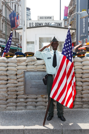 BERLIN, GERMANY - MAY 23: Former US Army Checkpoint Charlie bordercross in Berlin on May 23, 2014. The Best-known Berlin Wall crossing point between East and West Berlin during the Cold War. Its now a tourist attraction.