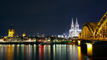 rhein: Riverside view of the Cologne Cathedral and railway bridge over the Rhine river, Germany