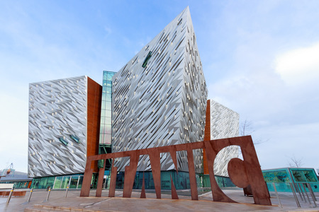 BELFAST, NORTHERN IRELAND - FEB 9, 2014: The Titanic visitor attraction and a monument in Belfast, Northern Ireland. Opened in 2012, this is the Titanic sign in front of the entrance.