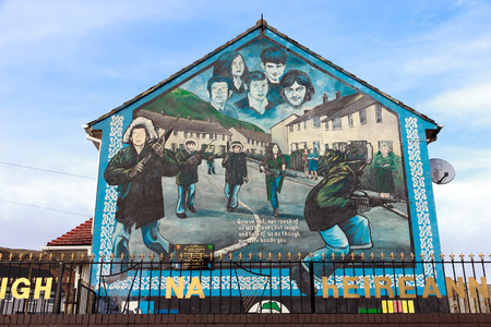 segregated: BELFAST, NORTHERN IRELAND - FEB 9, 2013: Mural in Glenalina Road containing five portraits of the IRA members commemorated in Belfast, Northern Ireland.